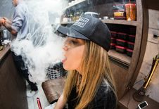 Free Young Woman Vaping In Restaurant Royalty Free Stock Photos - 91759358