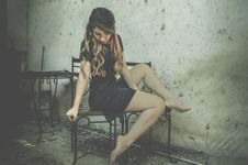 Free Woman On Chair In Dilapidated House Stock Images - 91760334