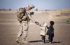 Free Soldier Giving Red Fruit On 2 Children During Daytime Royalty Free Stock Images - 91760589