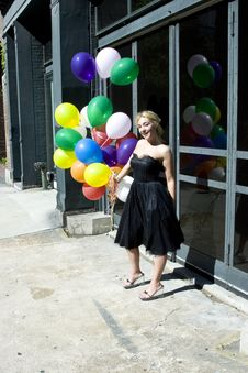 Young Blond Woman With Balloons Royalty Free Stock Images