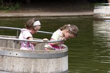 Free Twins Playing In A Barrel 01 Royalty Free Stock Photos - 920838