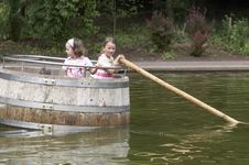 Twins Playing In A Barrel 03 Stock Image
