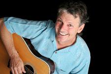 Grinning Guitarist Stock Photo