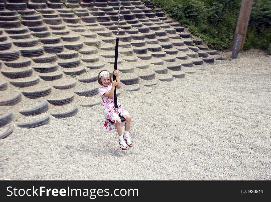 Young girl swinging 04