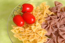 Butterfly Raw  Pasta And Tomato Stock Photos