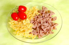 Butterfly Raw  Pasta And Tomato Royalty Free Stock Photography
