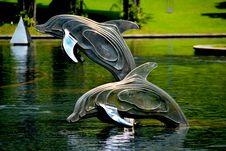 Free Gray And Brass Metal Dolphin Pool Decor Royalty Free Stock Images - 92133859