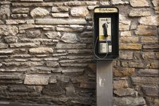 Free Gray And Black Telephone Booth Standing Near Gray Stone Wall At Daytime Royalty Free Stock Photo - 92160055