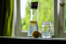 Free Shallow Focus Photography Of Yellow Lemon Near Glass Mason Jar And Glass Decanter Stock Photos - 92160113