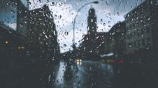 Free Glass With Rain Drops Across City Streets During Rainy Day Stock Image - 92160121