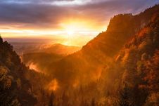 Free Sunset Over Mountains Royalty Free Stock Photo - 92160765