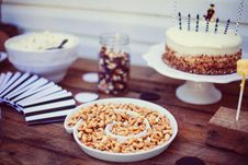 Free Birthday Party Cashews Nuts Tray Cake Black White Wood Stock Photo - 92161900