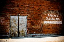Free Brick Wall Rustic Old Metal Doors Private Parking Royalty Free Stock Photography - 92162097