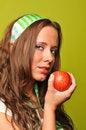 Free Brunette Holding Apple Royalty Free Stock Image - 9229926