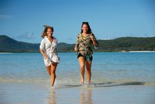 Free Two Young Women Runing Out Of The Water Royalty Free Stock Photography - 9222237