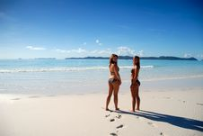 Free Two Young Girls Standing By Paradise Ocean Stock Photography - 9222242