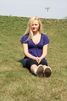 Free Girl Sitting Upon Grass Stock Image - 9224801