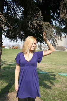 Girl Standing Under A Fir-tree Stock Photos