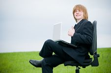 Free Smiling Young Businessman With Laptop Royalty Free Stock Image - 9226876