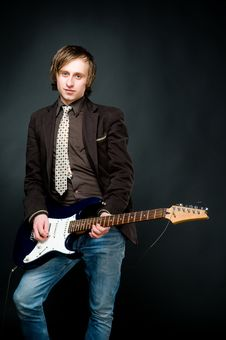 Free Young Man Playing Electro Guitar Royalty Free Stock Photography - 9227037