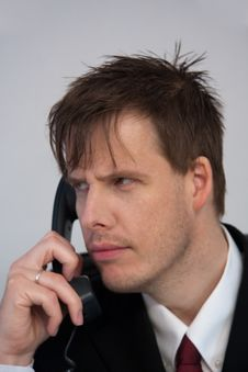 Free Businessman Answering Phone Royalty Free Stock Images - 9227739