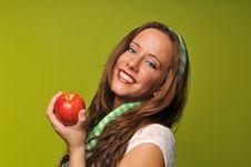 Free Brunette Holding Apple Stock Photos - 9229943