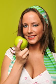 Free Brunette Holding Apple Royalty Free Stock Images - 9229959
