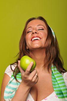 Free Brunette Holding Apple Stock Photography - 9229972