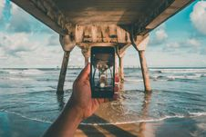 Free Taking Pictures While In The Sea Under The Jetty Royalty Free Stock Images - 92237789