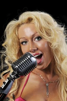 Free Blond Singer On Microphone Royalty Free Stock Photos - 9230028