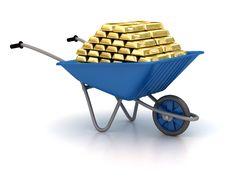 Garden Wheelbarrow With Gold Stock Photography