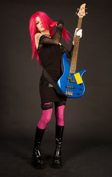 Free Attractive Girl Putting On Bass Guitar Royalty Free Stock Photos - 9235728