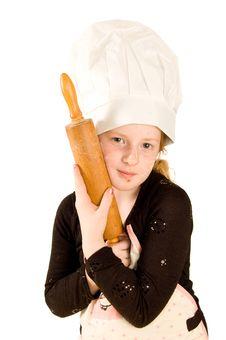 Cook Wearing A Chefs Hat Is Holding A Rolling Pin Royalty Free Stock Image