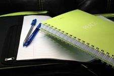 Free Green Spring Bind Book Beside 2 Blue Pens Royalty Free Stock Images - 92330449