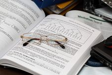 Free Textbook And Eyeglasses Stock Photos - 92330843