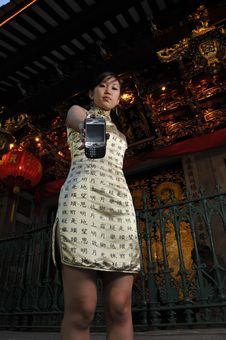 Free Beautiful Asian Woman With Communication Device Royalty Free Stock Images - 9240549