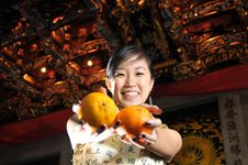 Free Beautiful Asian Woman Holding Oranges Royalty Free Stock Image - 9240646