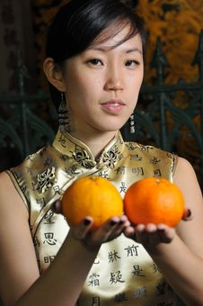 Free Beautiful Asian Woman Holding Oranges Stock Image - 9240801