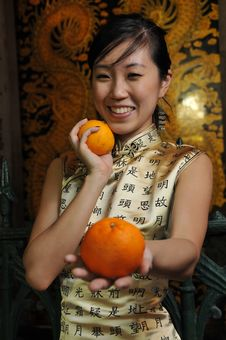 Free Beautiful Asian Woman Holding Oranges Stock Image - 9240991