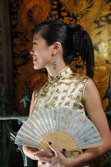 Beautiful Asian Woman Holding A Fan Royalty Free Stock Image