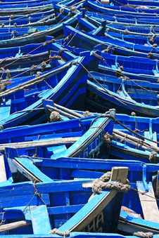 Blue Fishing Boats In Sunlight Royalty Free Stock Image
