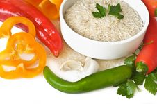 Red  And Green Peppers And Rice Royalty Free Stock Photos