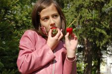 Girl With Strawberries Royalty Free Stock Image