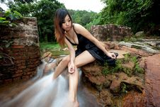 Relaxing Young Woman At Waterfall Stock Photography