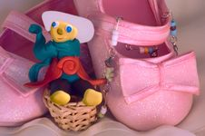 Plasticine Toy And Pink Shoes For A Baby Stock Image
