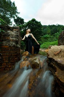 Relaxing Young Woman At Waterfall Stock Image