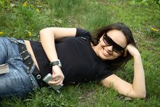 Beautiful Girl Lies On The Grass Royalty Free Stock Photography