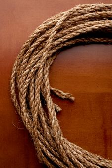 A Coil Of Rope On A Wooden Surface Stock Image