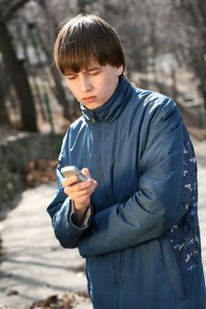 Teenager On The Phone Royalty Free Stock Images
