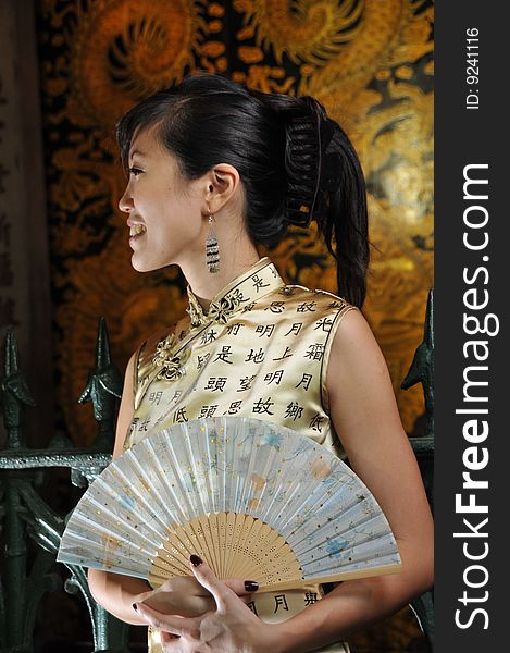 Beautiful Asian Woman Holding A Fan